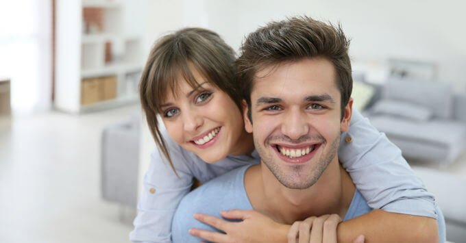 YOung couple in their rented home